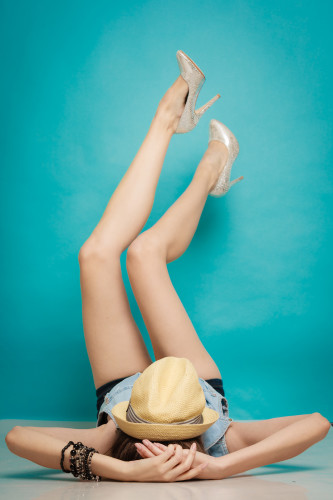 Fashion Girl Relaxed With Her Legs Raised Up